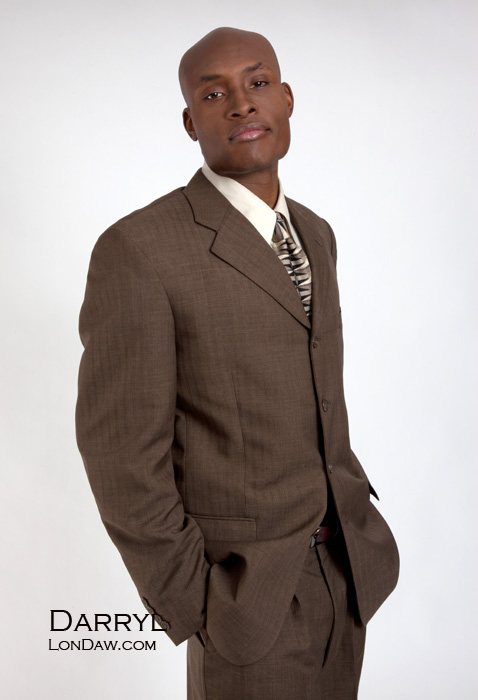 Model Darryl Miles in brown suit