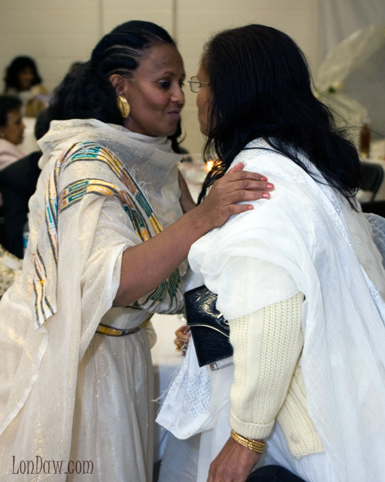 Warm greetings between two women in beautiful attire at Ethiopian Engagement Party in Washington, DC