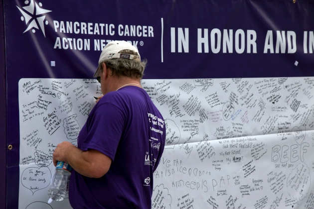 Walker signs Purple Stride In Honor In Memory Board 2011