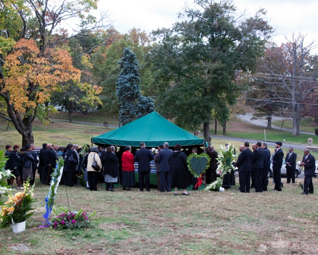 family gathered at cementary