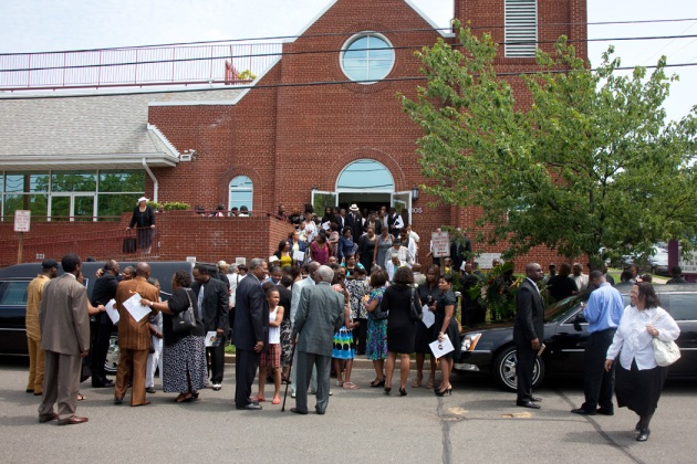 Mourners leaving church after funeral