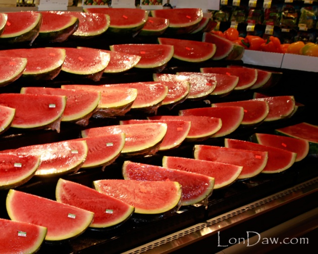 Cut watermelon on display in grocery story