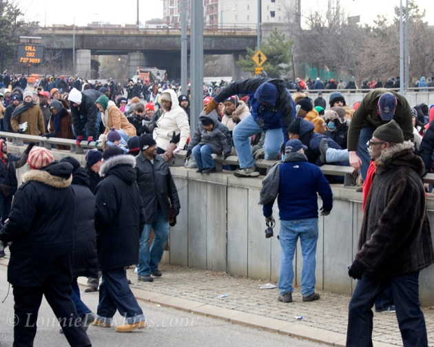 crowd climbing over highway barriers after Obama inauguration