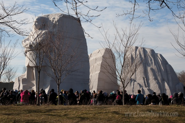 Martin Luther King Jr.National Memorial - crowd of people standing below stature
