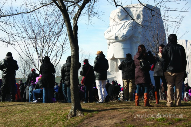 Crowd of people on hill looking at Stone of Hope at MLK Memorial
