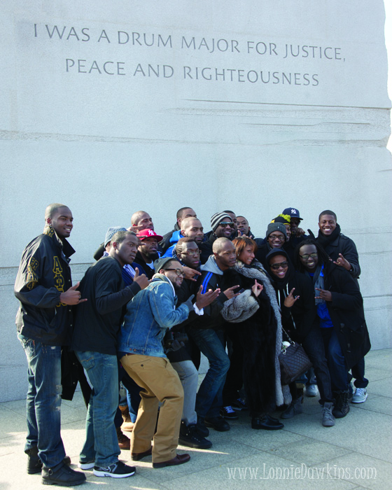 Fraternity posing in front of Stone of Hope at Martin Luther King Memorial