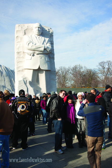 Large crowd gathered and posed in front of Stone of Hope at Martin Luther King Jr. Memorial