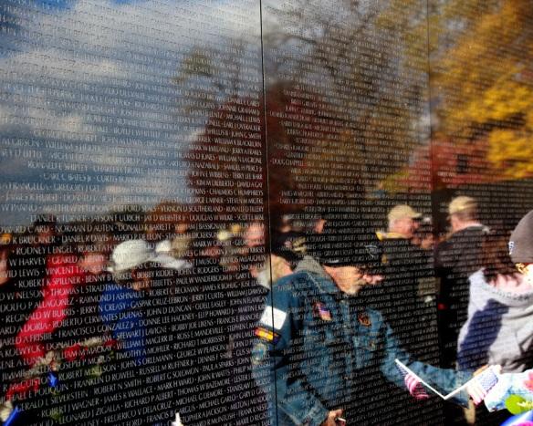 people gathering at the Vietnam Veteran Memorial Wall