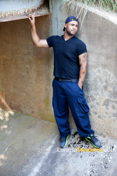 black male posing in tunnel at park