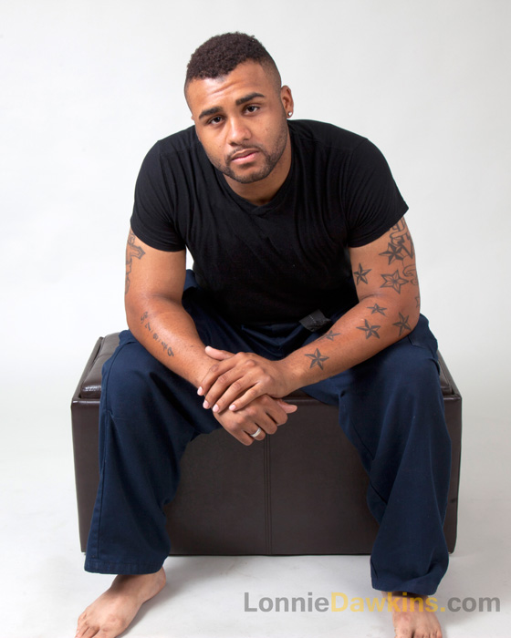 male posing on stool barefoot