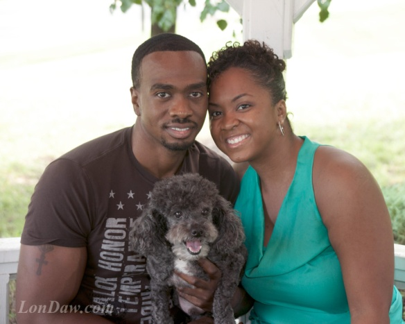 Engaged couple smiling with dog african american