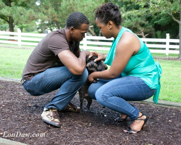 engaged couple kneeling with dog