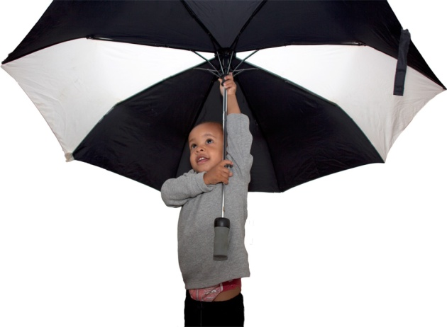 Little boy with huge black and white umbrella