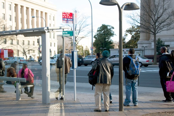 people waiting for bus at 7th and Penn in Washington DC