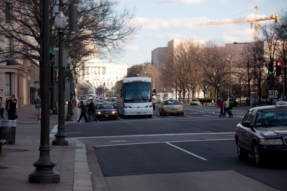 traffic on penn ave with capitol in background