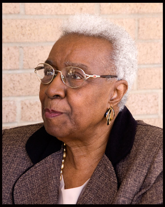 Annie Davis - woman-in-tweed-suit-with-glasses-smiling-african-american