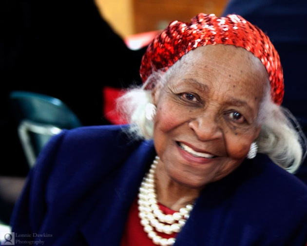 woman-pearls-red-hat-african-american