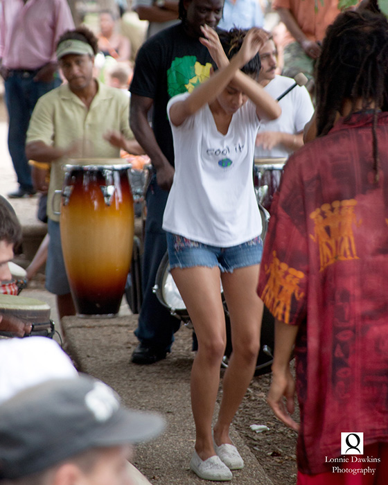 5n-Young woman dancing to drumbeat in Malcolm X park DC