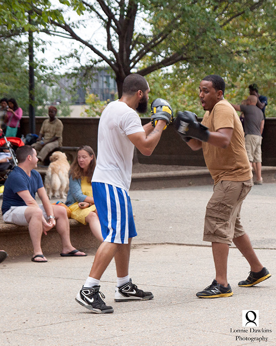 boxers boxing in park on Sunday afternoon