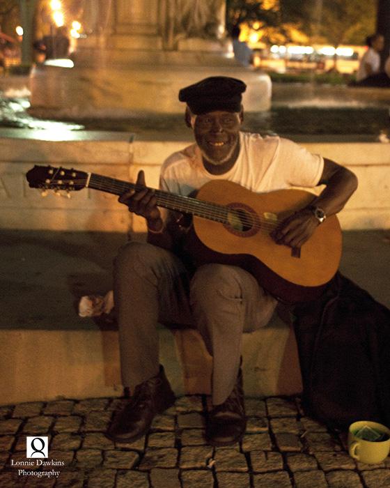 man playing guitar in Dupont Circle Washington DC night photography