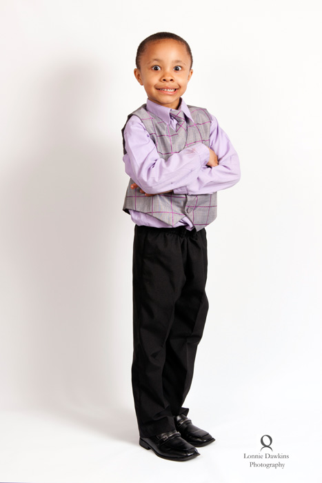 boy in vest arms crossed black pants african american