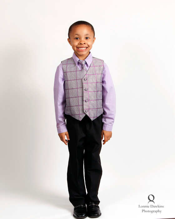 Smiling boy in vest and purple shirt