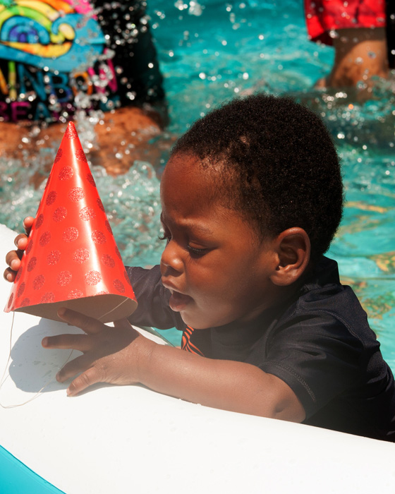 Baby's pool party - boy with birthday hat