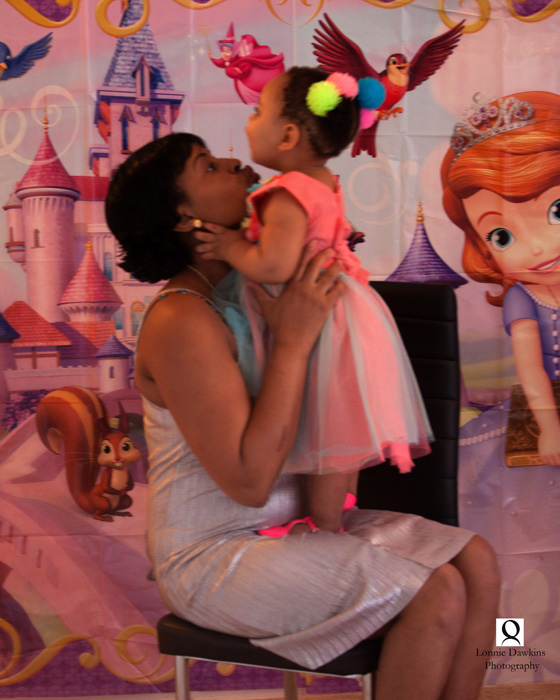 mother and baby girl hugging at birthday party