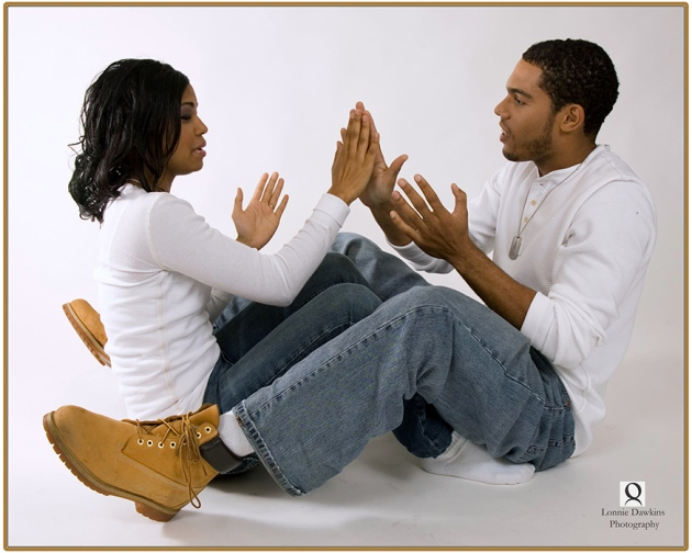 adult engaged couple on floor plying patty cakes