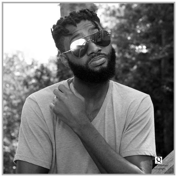 black man with beeard and sunshades