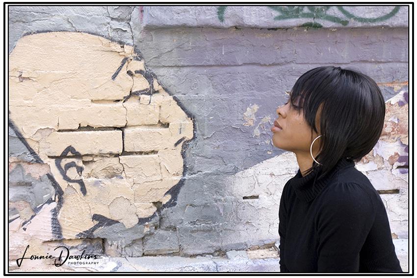 woman and wall mural in washington DC