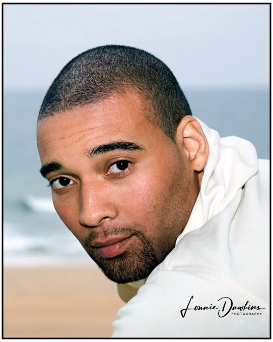 African American model head shot at beach