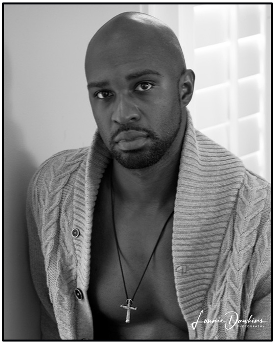 black bare chested handsome bald headed male model with beard