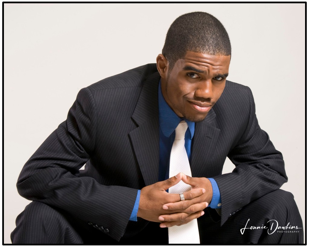 young black actor and model wearing suit and tie